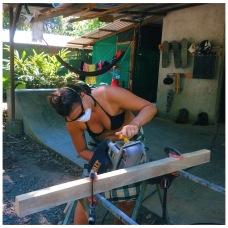 Team member, Hallie, rocking out the tools at the Finca Morpho Bodega